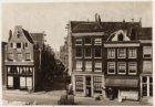 Prinsengracht 270 (ged.)-276 (v.r.n.l.). Naast nummer 276 de ingang van de Eland…