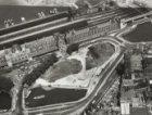 Luchtfoto Stationsplein en gedeeltelijk gedempt Open Havenfront