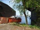 Insteekhaventje tussen houtloodsen nabij de Houthaven op het terrein van RIGA Ho…