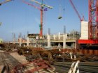 Bouw van het IJ-dock complex in het Afgesloten IJ aan de Westerdoksdijk