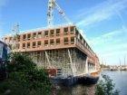 Bouw voor de bouw van nieuwbouwwoningen in de Oude Houthaven gezien vanaf de Van…
