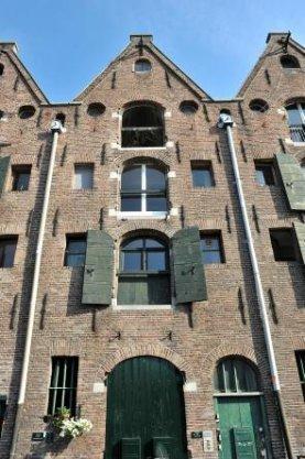 Zoutkeetsgracht 118 (detail). Tot appartementen omgebouwd pakhuis