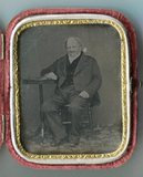 Visualizza Full length portrait of seated old man in a s… anteprime su