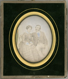 Miniaturansicht Vorschau von Three quarter portrait of a seated couple.