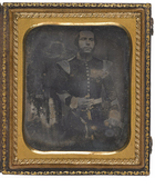 Thumbnail af A three quarter length portrait of a standing…