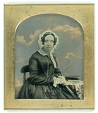 Visualizza Half length portrait of a seated woman with b… anteprime su