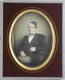 Visualizza Three quarter portrait of seated man with mou… anteprime su