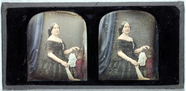 Miniaturansicht Vorschau von ¾ length portrait of a fairly young woman sta…