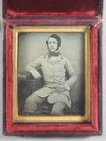 Thumbnail preview of Three quarter length portrait of a seated man…