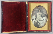 Visualizza Group portrait of three women, two seated and… anteprime su