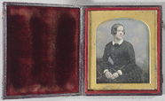 Thumbnail preview of Three-Quarter length portrait of a woman, sea…