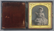 Thumbnail preview of Portrait of a young girl sitting facing the c…