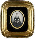 Thumbnail preview of Three-quarter portrait of a young woman in a …
