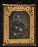 Visualizza Portrait of a man, half figure, seated. His l… anteprime su