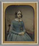 Visualizza Half length portrait of a young woman, seated… anteprime su