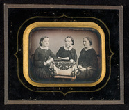 Visualizza Portrait of three young women seated around a… anteprime su