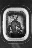 Visualizza portrait of a seated man in uniform anteprime su