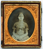 Thumbnail preview of Three quarter length portrait of a seated gir…