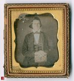 Thumbnail preview of Three quarter length portrait of young man ho…