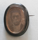 Thumbnail preview of A head and shoulders portrait of a man