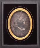 Visualizza portrait of seated woman holding a fan near t… anteprime su