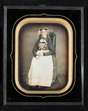 Thumbnail preview of Studio portrait of a bride in national costum…