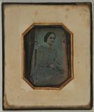 Visualizza Three quarter portrait of a seated woman hold… anteprime su