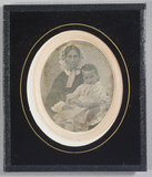 Visualizza Half-length seated woman with young boy on he… anteprime su