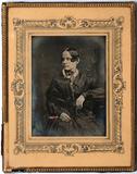 Visualizza Three quarter length portrait of a seated wom… anteprime su