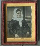 Visualizza Three quarter length portrait of seated woman… anteprime su