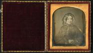 Visualizza Half length portrait of middle aged lady faci… anteprime su