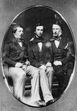 Visualizza portrait of three seated young man anteprime su