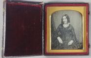 Visualizza Three quarter portrait of seated woman in a l… anteprime su