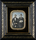 Thumbnail preview of Three-quarter portrait of a sitting couple