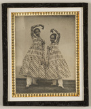 Visualizza Portrait of two girls in striped costumes, sm… anteprime su