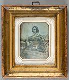 Visualizza Portrait of a woman in a striped dress, sitti… anteprime su