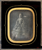 Thumbnail preview of Full portrait of a girl sitting on a chair , …