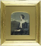 Thumbnail preview of Studio portrait of women sitting in armchair …