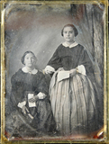 Thumbnail preview of Full portrait of two women with an envelope a…