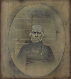 Visualizza A half length portrait of a man facing the ca… anteprime su