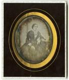 Visualizza Three quarter portait of seated woman near a … anteprime su