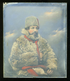 Visualizza Portrait of a seated man in a fur coat hat wi… anteprime su
