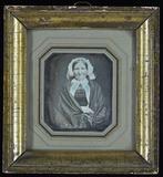 Visualizza Ältere Frau mit weißer Haube und einem Schult… anteprime su