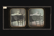 Thumbnail preview of Stereoscopic image of a table with a chair; o…