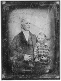 Visualizza portrait of a man with scarf, with a boy on h… anteprime su