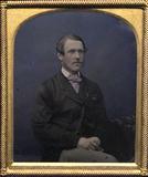 Miniaturansicht Vorschau von Portrait of a man, sitting in a chair