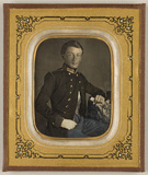 Visualizza Portrait of a young man in uniform, seated, r… anteprime su