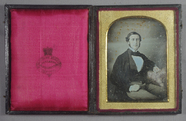 Thumbnail preview of A three quarter length portrait of a seated m…