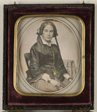 Visualizza Portrait of a woman with a plait, seated. A s… anteprime su