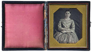 Thumbnail preview van Portrait of young woman with arms crossed